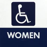 Vrouwentoilet-bord, met daarop de afbeelding van iemand in een rolstoel en het bijschrift \